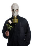 Environment Concept. Concept image of a man wearing a breathing apparatus and holding a flower, isolated against a white background Royalty Free Stock Photography