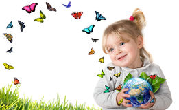 Environment concept, child holding earth with flying butterflies stock photography