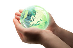 Glass globe in the grass. Environment concept, glass globe in the green grass stock photos