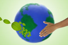 Environment concept. Environment concept Handshake between human hand and tree. Elements of this image furnished by NASA Stock Images