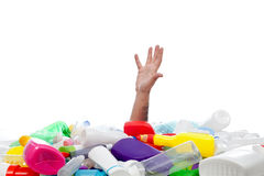 Environment concept with human hand and plastic recipients. Environment concept with human hand reaching out from beneath plastic recipients Royalty Free Stock Photography