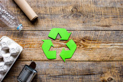 Environment concept with recycling symbol on rustic background top view mockup Stock Image