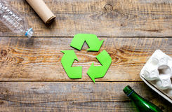 Environment concept with recycling symbol on rustic background top view mockup Royalty Free Stock Photo