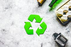 Environment concept with recycling symbol on stone background to stock photography