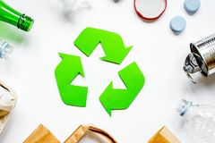 Environment concept with recycling symbol on white background to. Environment concept with recycling symbol for garbage disposal on white table background top Royalty Free Stock Photos
