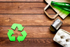 Environment concept with recycling symbol on wooden background top view mock up Royalty Free Stock Images