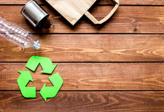 Environment concept with recycling symbol on wooden background top view mock up Stock Photos