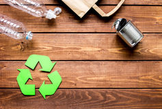 Environment concept with recycling symbol on wooden background top view mock up Stock Image