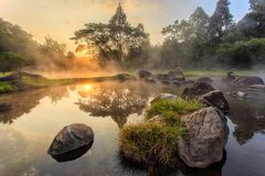 Environment hot spring in sunrise time at Jaeson National Park in Lampang Province royalty free stock photo