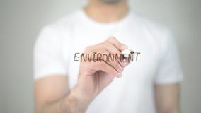 Environment, man writing on transparent screen stock photos