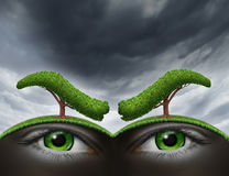 Environment Stress. And nature as a living entity with a green landscape as two human eyes underground with angry eyebrows made from trees as a metaphor for royalty free illustration
