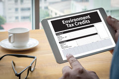 Environment Tax Credits Document Form Credits. Computing Computer Laptop with screen on table Silhouette and filter sun stock photography