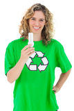Environmental activist holding a light bulb Royalty Free Stock Photography