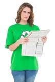Environmental activist holding newpaper looking at camera Royalty Free Stock Image