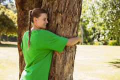 Environmental activist hugging a tree in the park Royalty Free Stock Photos