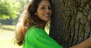 Environmental activist hugging a tree stock video