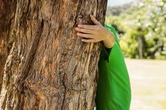 Environmental activist hugging a tree Royalty Free Stock Photo