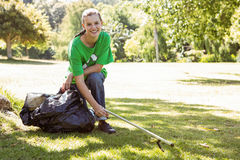 Environmental activist picking up trash Stock Photography