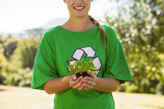Environmental activist showing a plant Royalty Free Stock Photo