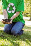 Environmental activist about to plant tree Royalty Free Stock Photo