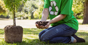 Environmental activist about to plant tree Stock Images