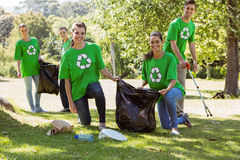 Environmental activists picking up trash Stock Photos