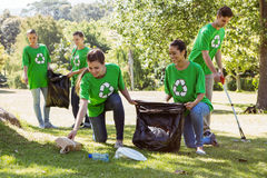 Environmental activists picking up trash Royalty Free Stock Photos