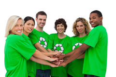 Environmental activists putting their hands together Stock Photo