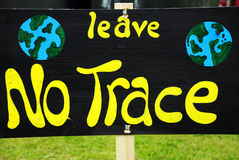 Environmental Anti-Litter Sign. A hand-painted sign reading 'Leave No Trace', as an environmental message against leaving litter Stock Photo