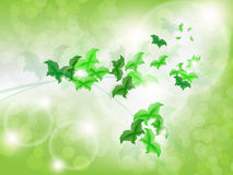 Environmental Background with green leaf butterflies. On a light green background with bokeh lights Stock Photo