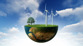 Environmental concept, earth globe holding wind turbines against blue sky stock footage