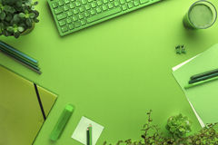 Environmental concept of a green office desk with supplies Royalty Free Stock Images