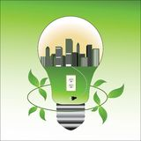 Environmental concept lightbulb and city Stock Photo