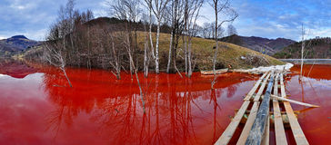 Environmental disaster. Panorama of a lake full with contaminate. D water from a mine in Geamana, Rosia Montana, Romania stock photography