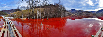 Environmental disaster. Panorama of a lake full with contaminate. D water from a mine in Geamana, Rosia Montana, Romania stock image