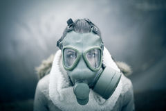 Environmental disaster.Woman breathing trough gas mask,health in danger.Concept of pollution Stock Images