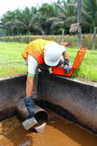Environmental Engineer collecting sample. An environmantal engineer collecting sample Royalty Free Stock Images