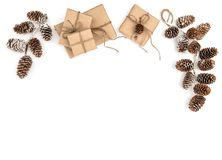 Environmental friendly Christmas gifts wrapped in recycled craft paper. Gift boxes isolated in white background stock photo