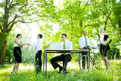 Environmental Friendly Themed Picture Of Business People Working Royalty Free Stock Images