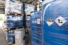 Environmental hazard barrels. Waste barrels with hazard warning symbols in the warehouse royalty free stock photos