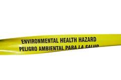 Environmental Health Hazard Tape. Environmental Health Hazard warning tape on a chain link fence royalty free stock image