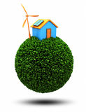 Environmental house. Isolated 3D environmental house on a green planet Royalty Free Stock Photography
