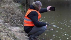 Environmental inspector checks the river pollution stock video
