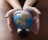 Environmental issues and whole world in hands Royalty Free Stock Image