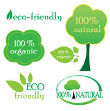 Environmental labels. With 100% natural, organic and eco-friendly text stock illustration