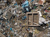 Environmental pollution. Aerial top view photo from flying drone of large garbage pile. stock images