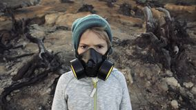 Environmental pollution, disaster, nuclear war concept. Child in protective mask