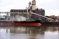 Environmental pollution during loading river vessels Royalty Free Stock Image