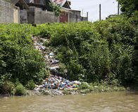 Environmental pollution. Moving home  garbage to river making   environmental pollution Royalty Free Stock Image