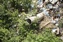 Environmental pollution. Moving home  garbage to river making   environmental pollution Royalty Free Stock Photo